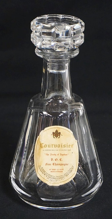 BACCARAT CRYSTAL DECANTER WITH AN OLD COURVOISIER PAPER LABEL. 9 1/4 INCHES HIGH