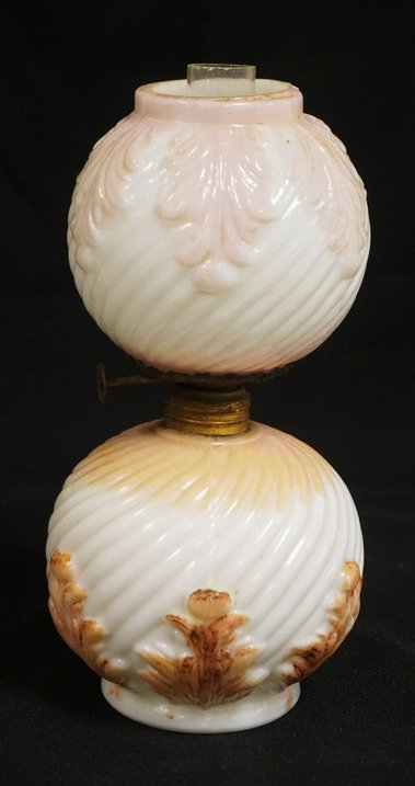 MINATURE MILK GLASS OIL LAMP HAVING SWIRLED RIBS AND ACANTHUS DECORATIONS. 8 1/4