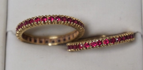 PAIR OF 14K GOLD RINGS ENCIRCLED WITH RUBIES. 2.45 DWT. APPROX SIZE 7 1/2.