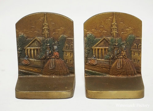 PAIR OF BRADLEY & HUBBARD POLYCHROME DECORATED IRON BOOKENDS WITH A COUPLE WALKI