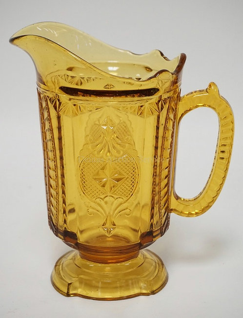 EAPG AMBER MEDALLION PITCHER MEASURING 8 5/8 INCHES HIGH.