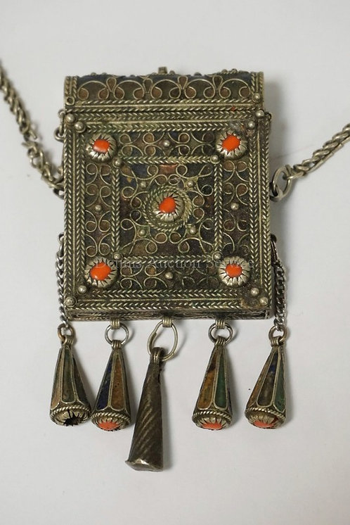 NORTH AMERICAN PENDANT CONTAINER WITH INSET RED STONES AND ENAMEL DECORATED TASS