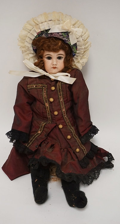 GERMAN BISQUE HEADED DOLL MEASURING 18 INCHES LONG. LEG IS DETACHED.