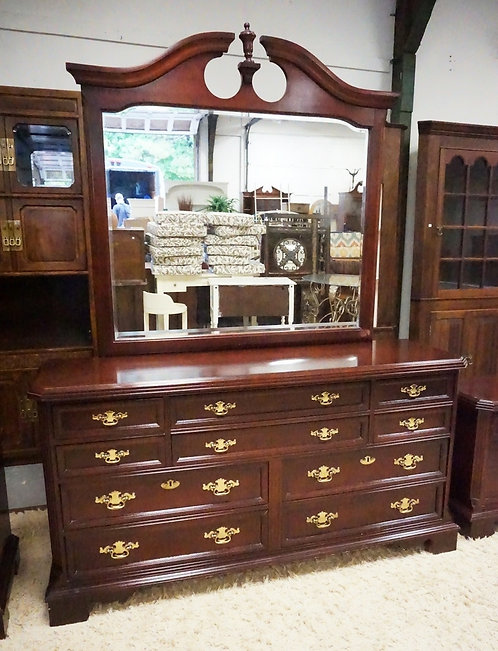 BASSETT LOW CHEST OF DRAWERS WITH MIRROR. 66 INCHES WIDE.