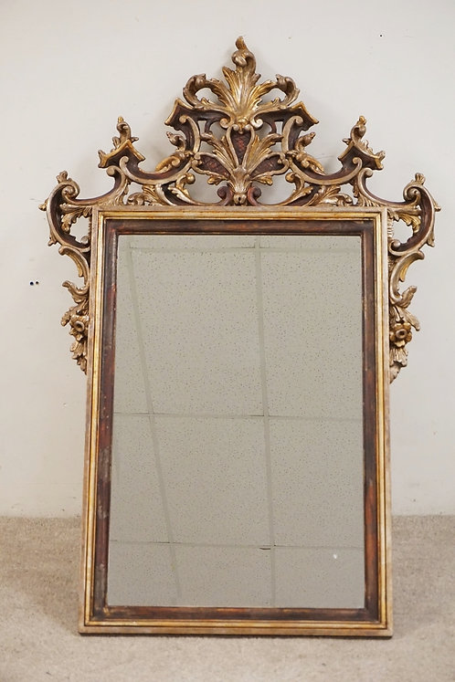 LARGE WALL MIRROR WITH AN ORNATE OPENWORK CARVED FRAME. 41 X 60 INCHES.
