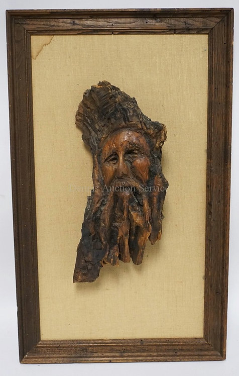 CARVED DRIFTWOOD DEPICTING THE FACE OF A MAN. 15 3/4 INCHES LONG NOT INCLUDING F