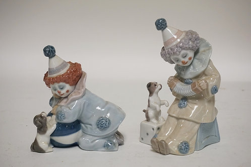 LOT OF 2 LLADRO PORCELAIN FIGURES OF CLOWNS WITH PUPPIES.