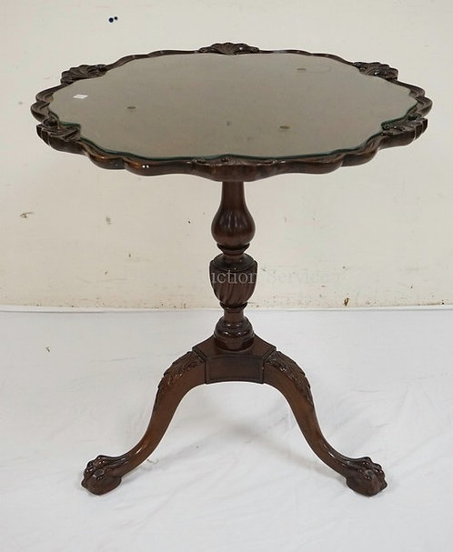 MAHOGANY LAMP TABLE WITH A CARVED EDGE, CARVED URN STEM, AND CARVED BALL AND CLA