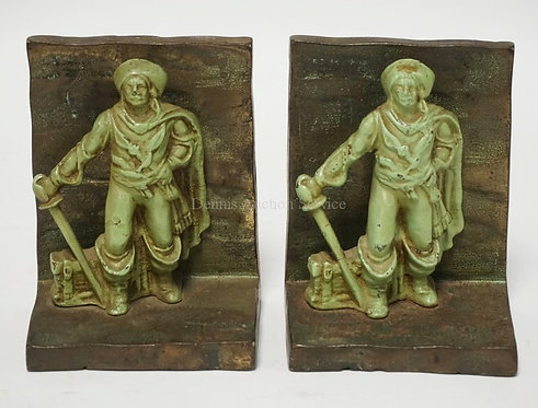 PAIR OF FIGURAL BRONZE BOOKENDS WITH PAINTED FIGURES OF PIRATES WITH A TREASURE