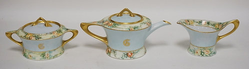 HUTSCHENREUTHER PORCELAIN TEAPOT, CREAM, AND SUGAR WITH HAND PAINTED DECORATION