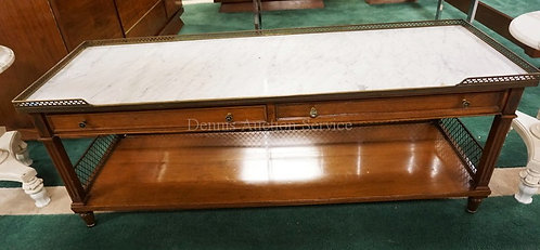 MARBLE TOP COFFEE TABLE WITH A BRASS GALLERY AND 2 DRAWERS. 54 INCHES WIDE. 21 I