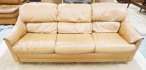 LIGHT BROWN LEATHER SOFA.