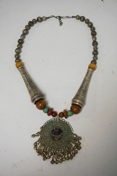 BEADED NECKLACE WITH AN ANTIQUE NOMAD PENDANT WITH ANTIQUE AMBER BEADS.