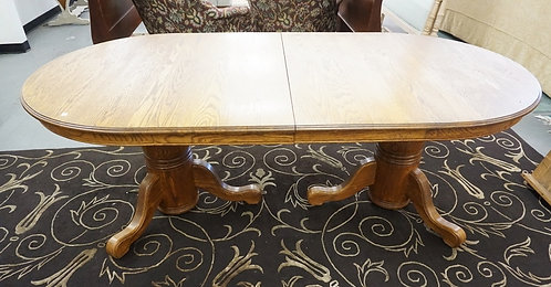 OVAL OAK DINING TABLE W/TWO 16 1/.2 IN LEAVES. 83 IN X 42 IN CLOSED