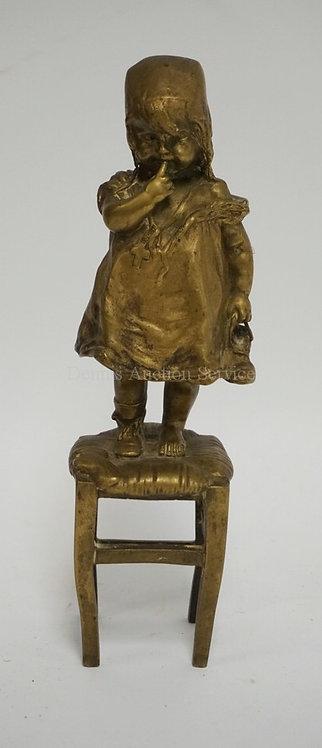 FREIDERICH GOLDSCHEIDER BRONZE FIGURE OF A GIRL STANDING ON A STOOL HOLDING A SH