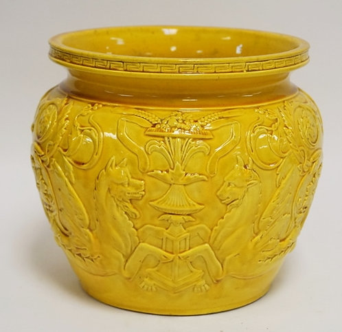 ASIAN POTTERY JARDINIERE WITH RELIEF DECORATION OF DRAGONS FLANKING A FLOWERING