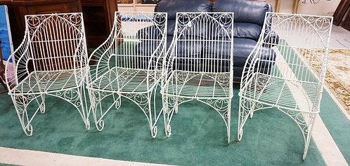 SET OF 4 ORNATE WIRE CHAIRS.