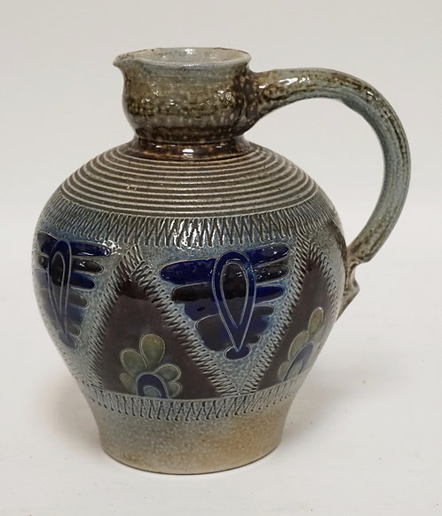 STONEWARE PITCHER. 8 1/4 INCHES HIGH.