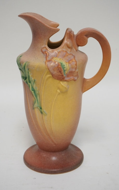 ROSEVILLE *PEONY* ART POTTERY EWER. 10 1/4 INCHES HIGH. HAS A FLAT FLAKE ON THE