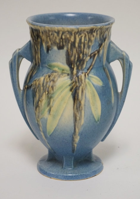 ROSEVILLE POTTERY MOSS PATTERN VASE. 7 1/2 INCHES HIGH. HAS A CHIP ON THE FOOT.
