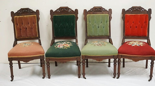 SET OF 4 CARVED WALNUT VICTORIAN SIDE CHAIRS WITH VARYING NEEDLEPOINT AND UPHOLS