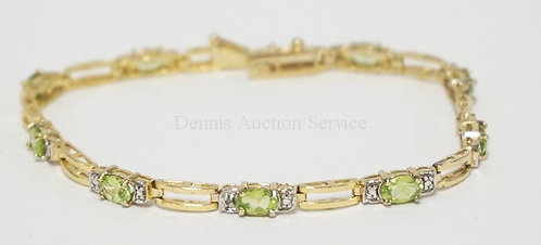STERLING SILVER TENNIS BRACELET WITH PERIDOT AND DIAMOND ACCENTS. 7 1/2 INCHES L