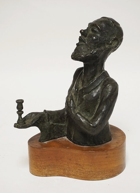 JEWISH BRONZE SCULPTURE OF A MAN HOLDING A CANDLESTICK. INSCRIBED *M. SPERTUS* (