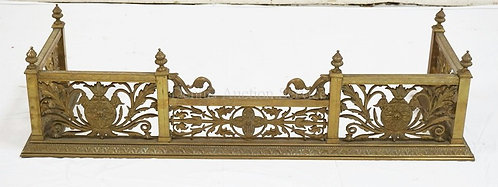 ORNATE BRASS FIREPLACE FENDER. 42 INCHES WIDE AND 11 INCHES HIGH.