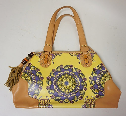 LEATHER PURSE BY SHARIF. YELLOW ON ONE SIDE AND PATTERNED ON THE OTHER. 16 INCHE