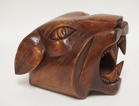 CARVED WOODEN SCULPTURE OF AN ANIMAL HEAD. 7 INCHES HIGH.
