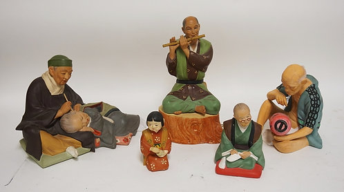 GROUP OF 5 HAKATA URASAKI CERAMIC DOLLS. TALLEST IS 10 INCHES. ONE IS MUSICAL.