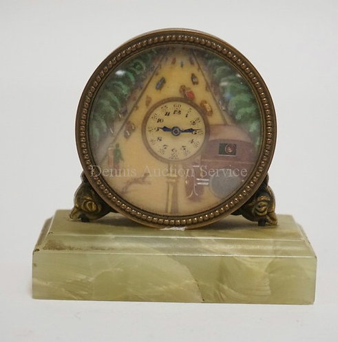 SWISS DESK CLOCK WITH A HAND PAINTED FACE DEPICTING A ROADWAY WITH CARS, PEOPLE,