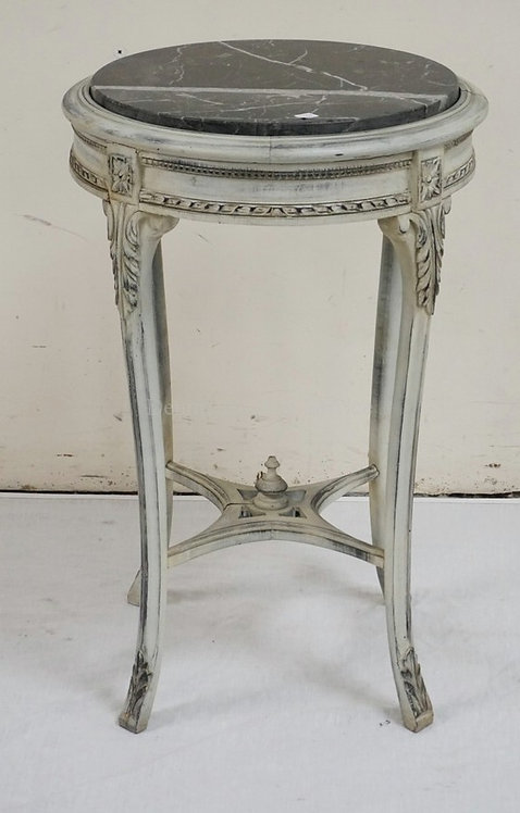 CARVED LAMP TABLE WITH AN INSET MARBLE TOP AND A WHITE FINISH. 18 1/2 INCH DIA.