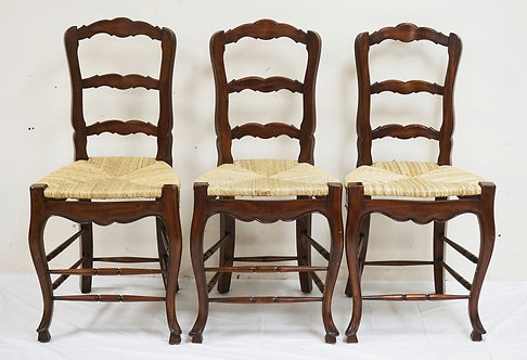 3 BAR STOOLS WITH RUSH SEATS AND CUTWORK SLATS. 47 1/2 INCHES HIGH.