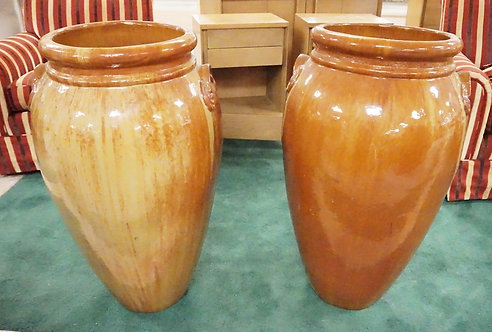 PAIR OF POTTERY FLOOR OR GARDEN VASES IN A BUTTERSCOTCH AND RUST COLORED GLAZE.