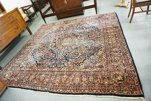 ROOM SIZE ORIENTAL RUG MEASURING 9 FT SQUARE.