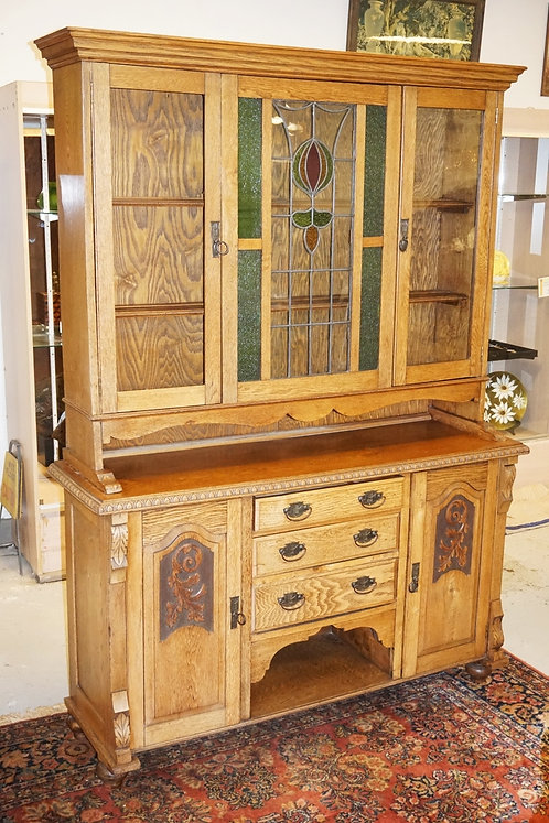 CARVED OAK HUTCH WITH STAINED GLASS. 60 1/4 INCHES WIDE. 84 1/4 INCHES HIGH.
