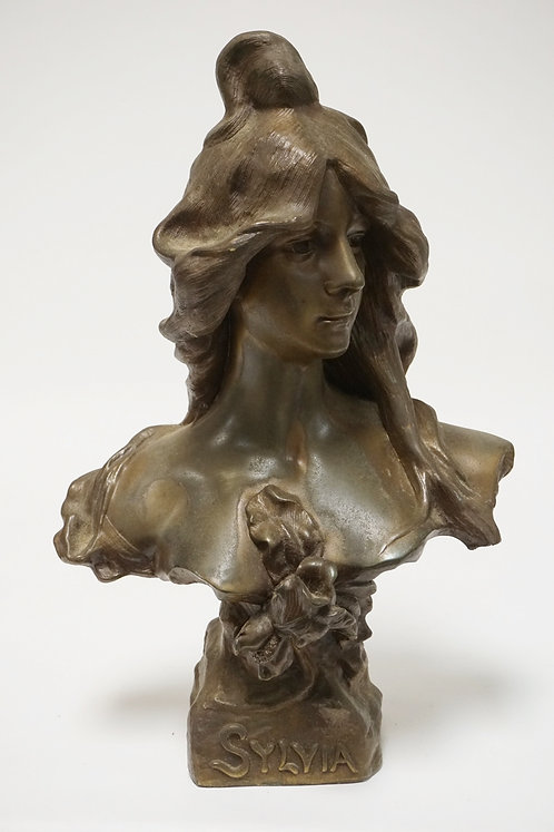 METAL SCULPTURE OF A BUST TITLED *SYLVIA*. 17 1/2 INCHES HIGH.