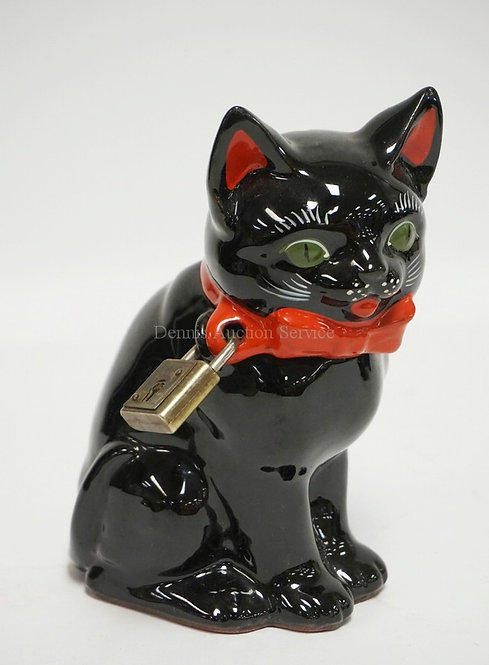 NAPCO *TOMMY* BLACK CAT COIN BANK WITH LOCK. NO KEY. 6 3/4 INCHES HIGH. PAPER LA