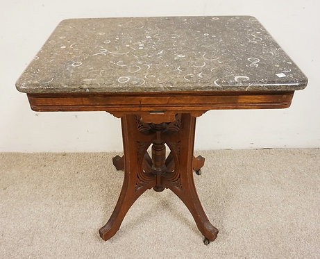 VICTORIAN MARBLE TOP LAMP TABLE WITH A CARVED BASE. 28 1/2 X 20 INCH TOP. 29 1/2