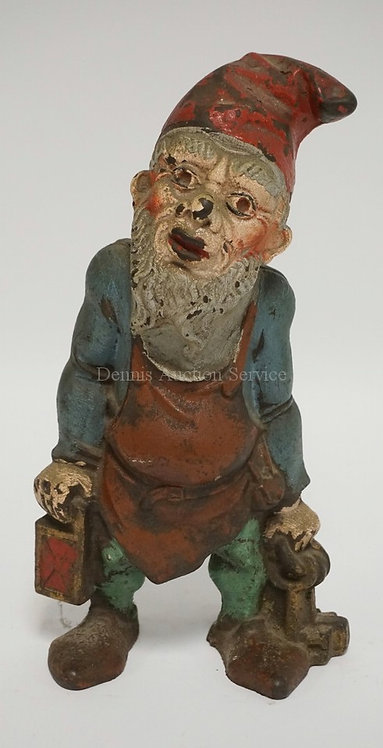 ANTIQUE CAST IRON GNOME WITH LANTERN & KEYS DOORSTOP BY NUYDEA. 10 INCHES HIGH.