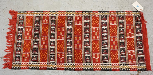MOROCCAN RUG MEASURING 4 FT 6 INCHES X 2 FT 2 INCHES.