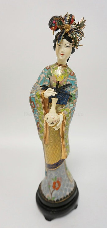 CLOISONNE FIGURE OF A WOMAN HOLDING A VASE WITH FLOWERS. SH HAS A BRASS MESH AND