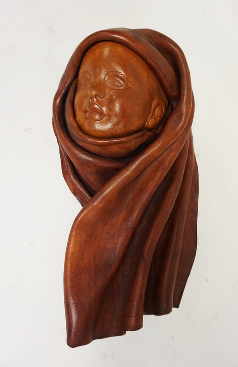 SCULPTED LEATHER FIGURE MEASURING 18 1/2 INCHES LONG.