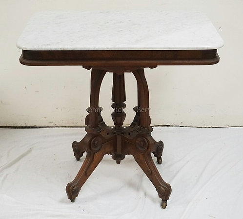 VICTORIAN MARBLE TOP TABLE WITH A CARVED BASE AND BURLED PANELS. 32 X 23 INCH TO