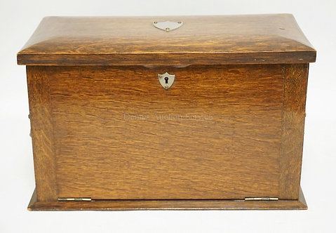 ENGLISH OAK TRAVELING DESK WITH A DROP FRONT WRITING SURFACE, LETTER SLOTS, DRAW