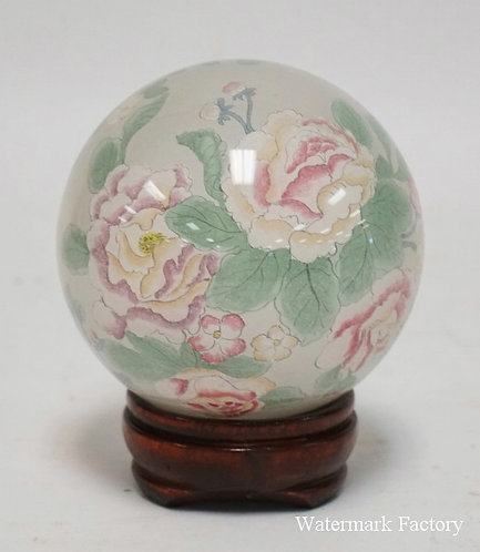 INTERNALLY DECORATED BLOWN GLASS ASIAN BALL WITH STAND.4 1/2 INCHES HIGH.