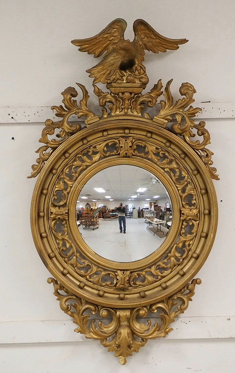 ANTIQUE FEDERAL BULLSEYE GILTWOOD MIRROR WITH AN EAGLE CREST AND AN ORNATE OPENW