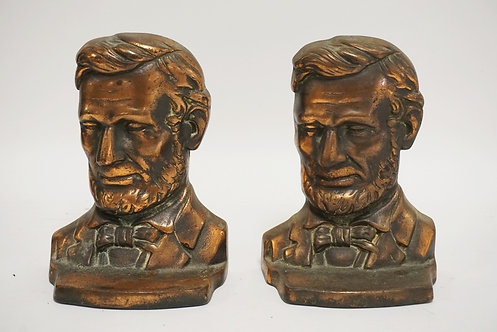 PAIR OF CAST IRON ABRAHAM LINCOLN BOOKENDS WITH A BRONZE FINISH. 6 1/4 INCHES HI