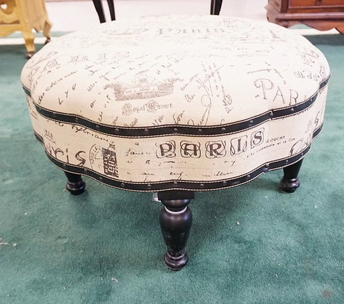 CONTEMPORARY OTTOMAN WITH PARISIAN UPHOLSTERY. APPROX 30 INCH DIA.